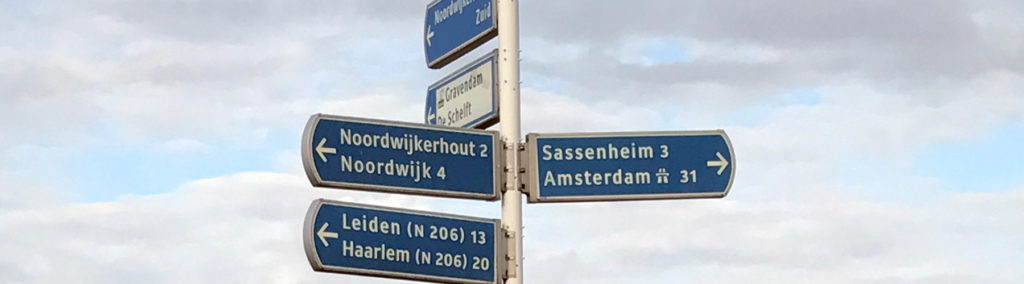 street sign with Dutch cities in Netherlands