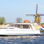 Dutch motorboat on lake in South Holland Netherlands