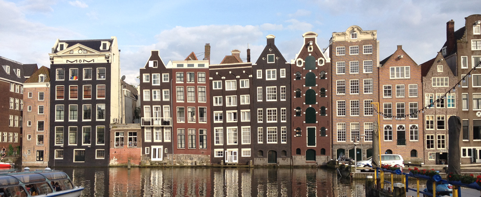 tall narrow Dutch canal houses in Amsterdam Netherlands