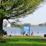 children swimming at Kaag Lake in South Holland Netherlands