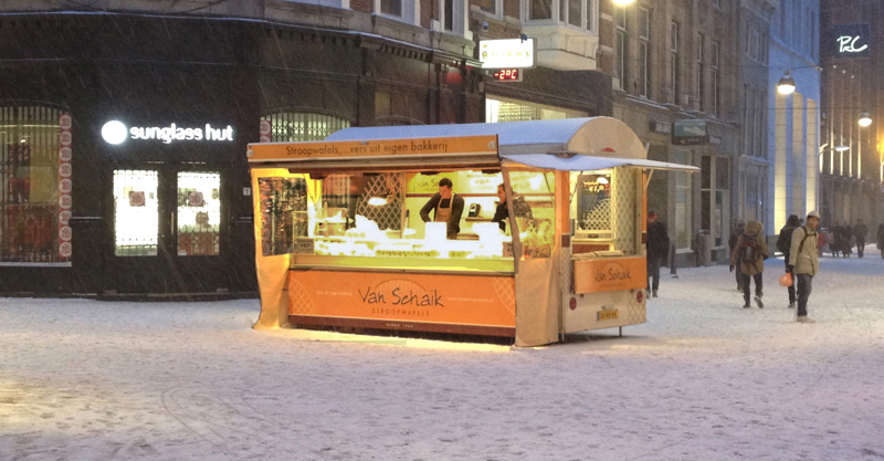 snow accumulating in The Hague Netherlands near stroopwafel stall