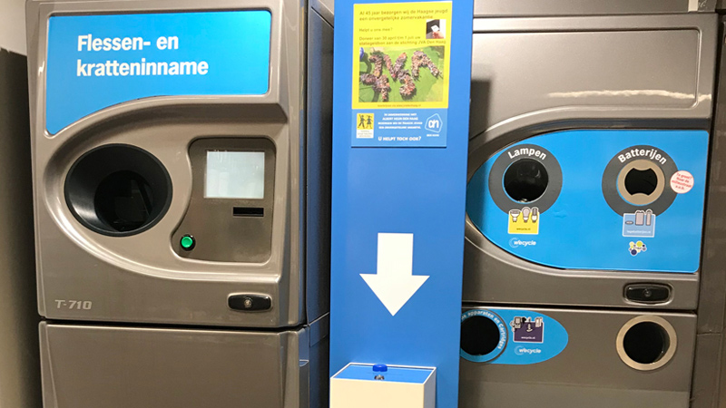recycling machine and battery lightbulb collection spot in Dutch supermarket