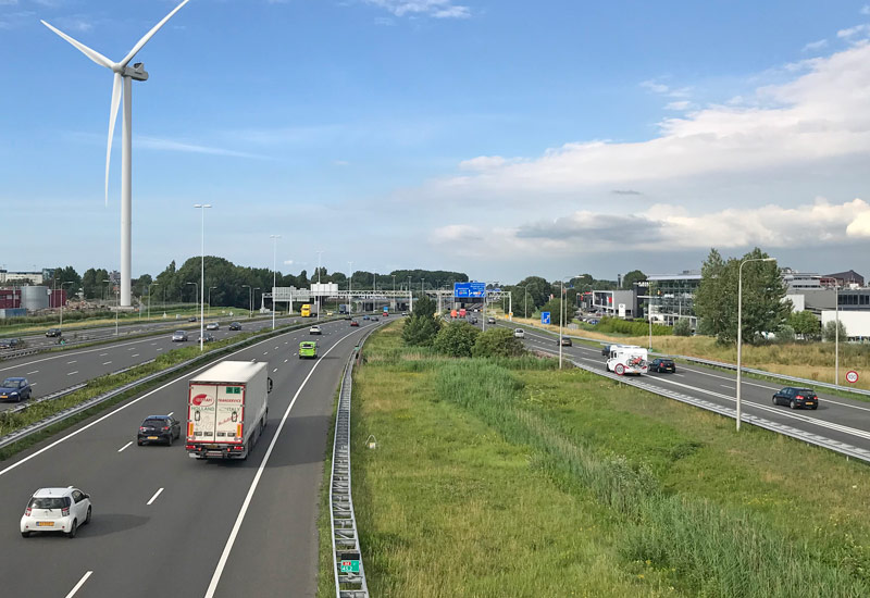 cars trucks driving on Dutch motorway in the Netherlands